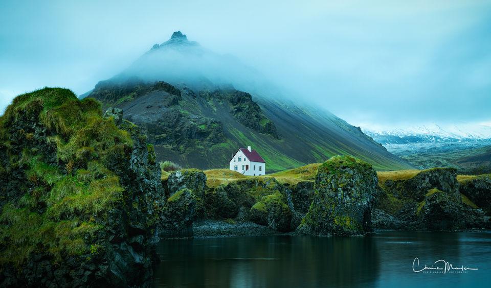 Iceland, Snaefellsnes Peninsula, Arnarstapi, Stapi, fishing village, Mt. Stapafell, cottage