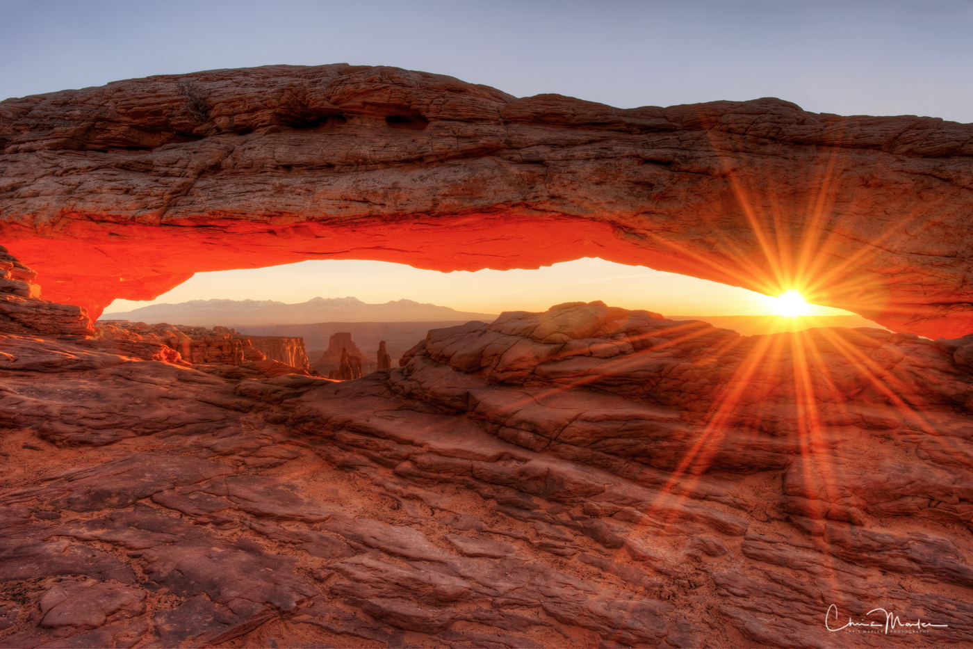 A classic shot of Mesa Arch at sunrise.  This once relatively obscure location is now world famous, and photographers flock here...