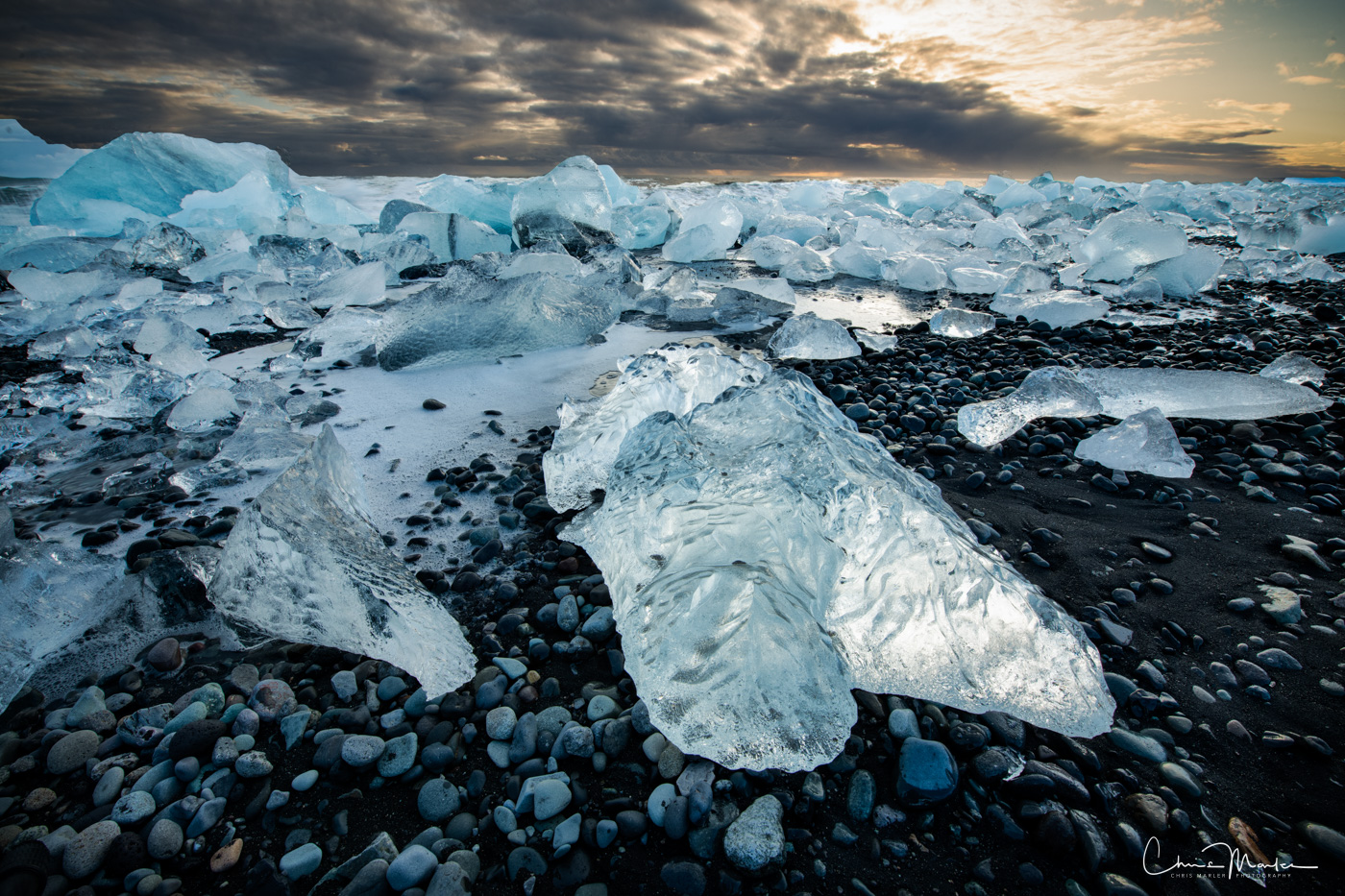 Icebergs littered Iceland's Diamond Beach for over a mile on this particular day.  Jokulsarlon Glacier Lagoon was providing an...